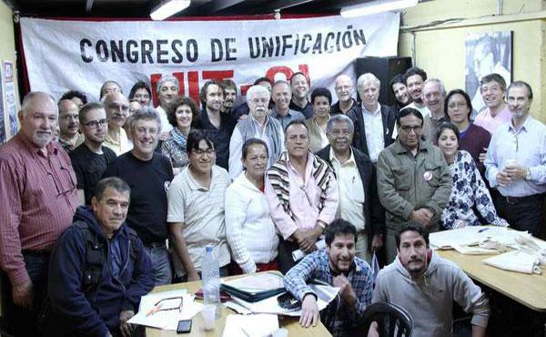 Las delegaciones de los 13 países que estuvieron representados, posan al final del Congreso para celebrar el éxito de la Unificación.